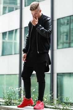Shop this look on Lookastic:  https://lookastic.com/men/looks/black-bomber-jacket-black-polo-black-sweatpants-red-athletic-shoes/13152  — Black Leather Bomber Jacket  — Black Polo  — Black Sweatpants  — Red Athletic Shoes