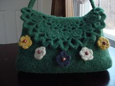 Ravelry: lacy-flap felted bag pattern by Lauren Irving