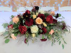 Loved it! Pinned it! A Blooming Envy Design! Arrangement designed with Burgundy Dahlias, Peach Roses, White Roses, Burgundy Roses, Burgundy Scabiosia, Chocolate Queen Anne's Lace and eucalyptus.