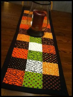 Simple Halloween table runner.  link does not work but this would be nice using cuter halloween fabric?