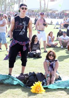 2013: Sits on a blanket in field, waiting for a response from Coachella gods. | A History Of Vanessa Hudgens At Coachella