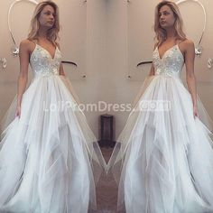 Silhouette:  A-line    Neckline:  Spaghetti Straps    Waist:  Natural    Hemline/Train:  Floor-length    Embellishment:  Tiers    Fabric:  Tulle    Fully Lined:  Yes    Built-in Bra:  Yes