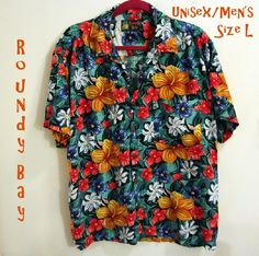 Trendy Tropical Top, bold colors - awesome!!! EUC ROUNDY BAY shirt in bright oranges & green/blue. Purchased at South Padre Island, TX; worn only once or twice.  Men's/unisex size Lg.  From SFPF home. Bundle 2 or more shirts for add'l 15% discount.  Thanx 4 looking!!! Roundy Bay Tops
