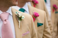 love the boutonnieres with pops of color via gems in the flowers