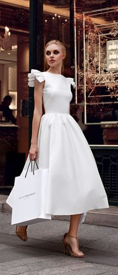 the modern lady - clean lines, full skirt, cropped hemline, shoulder detail | image via: yulia prokhorova