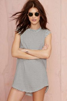 Get in line (or don't) in this white tee with black stripes, cap sleeves, and a scoop neckline.