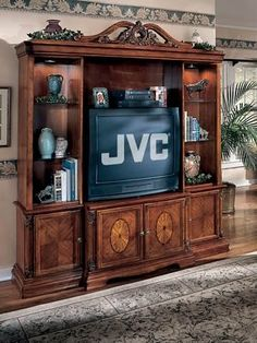 Add beauty to your TV room with this elegant entertainment center available at Furniture Plus!
