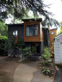 Modern exterior by John Prindle. The modern wood and clapboard exterior is a great twist on an old look.