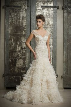 """Designed and manufactured in New York City the Enaura Bridal collection is created for the discerning bride with an admiration for a feminine silhouette, rich embroidery, luxury silk fabrics, and intricate beadwork."" Take a look at the latest collection of Enaura Bridal Wedding Dresses, happy pinning!"