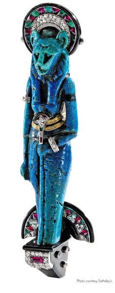 Goddess Sekhmet brooch, Cartier. Egyptian, type of quartz ceramic thought to be 2500-3000 year old.