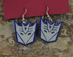 Decepticon Earrings! Give me some Autobot ones and I'll be happy!