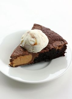 """I took a half pound giant Reese's Peanut Butter cup, put it in the middle of a skillet, surrounded it with chewy brownie batter, added in more baby peanut butter cups, baked it, rolled my eyes heavenward and said """"Amen."""" #recipes #chocolate"""