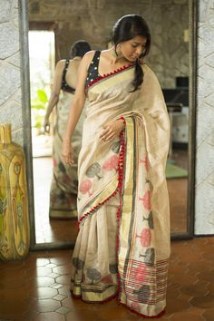 Tussar loving again! A lovely tussar saree with black and red tree motifs woven…