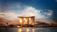 With stunning views all around and sporting a long infinity swimming pool set on top of the world's largest public cantilevered platform, the Marina Bay Sands hotel opened up to much fanfare on June in Singapore. Sands Singapore, Visit Singapore, Singapore Travel, Hotel Marina Bay Sands, Sands Hotel, Amazing Buildings, Amazing Architecture, Singapore Architecture, Futuristic Architecture