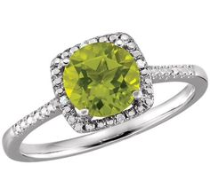 Genuine Peridot and Diamond Halo Ring, 7mm round Peridot with Diamond accents, .015ctw., Sterling Silver, stock size 7. Matching Pendant and Earrings available.