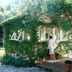 I have this dream that one day Jer and I will build a little retreat like this one on a deck in the ivy in our backyard...not so much a bath/spa house but more of a yoga studio/relax-with-a-glass-of-wine type thing. Sigh...someday.