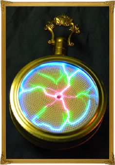 """The Clockwork Electric Disturbance Indicator: pocket-size plasma light turned into a """"pocket watch"""" using a canning jar lid and a lamp finial."""