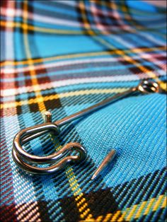 A kilt with a giant pin