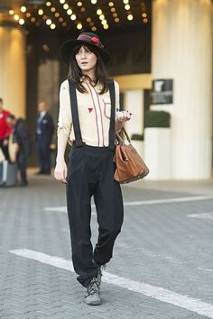 Irina in jumper and suspenders