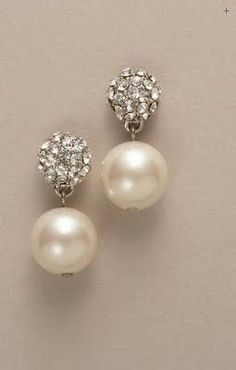If I wasn't wearing my grandmother's pearl earrings, these would be my next choice for the wedding. So simple & pretty.