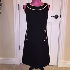 Ann Taylor LOFT Black and White Dress Never worn, NWOT. Size 4. Thick fabric. Zips in back. Pockets in front. Ann Taylor Dresses Midi