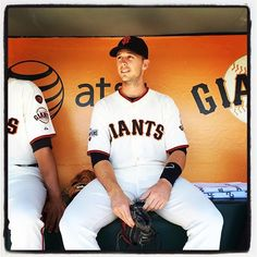 Buster Posey sits in the dugout at #attpark. Photo by @punkpoint