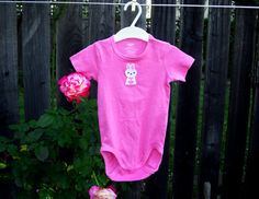 Pink short sleeved organic cotton bodysuit is embellished with a bunny applique.  9-12 months only $16.19 clearance price