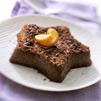 Chocolate-Orange Custards    This low fat chocolate dessert relies on only 3 tablespoons added sugar for the whole recipe. Use a high-quality chocolate for the best flavor.   YIELD: 4 individual custards  CARB GRAMS PER SERVING: 23