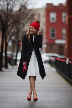 A classic black coat will get you through the darkest of winters. Plus, that hat! #winter #stylegallery
