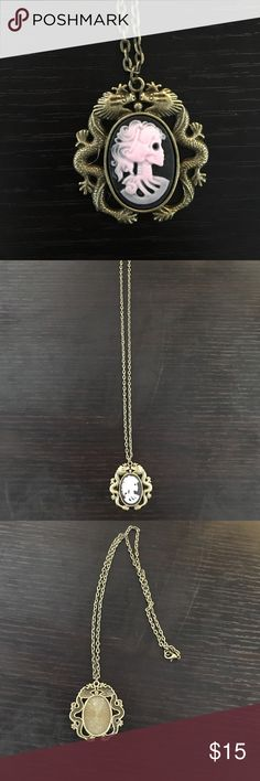 """Pink skeleton cameo pendant necklace Antique bronze skeleton cameo pendant necklace. Pendant is dragon design. pendant is 1.5"""". Chain length can be customized if desired. Perfect piece of fashion jewelry Custom Jewelry Necklaces"""