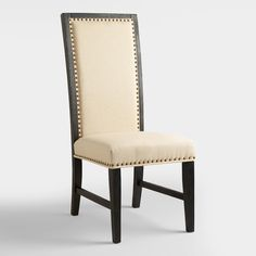 Upholstered in creamy linen, our Black Greyson Side Chair looks as if it's been in the family for generations. Crafted of acacia wood with a textured finish, it's detailed with nail head accents for elevated elegance.