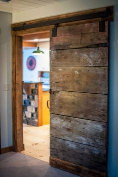 Antique barn board sliding barn door in Boulder Meadows small barn home. Click thru to see more & fl plns. #timberframe #barnhomesplans #barnhouses                                                                                                                                                      More