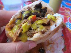 An arepa doused in secret sauce at Caracas Arepa Bar. New York, NY.     See the whole meal at EdiesBathrobe.com