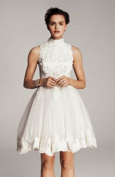 Short lace wedding dress, it is so beautiful and lovely! Besides, it's also modest.