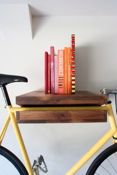 A beautiful wooden bicycle shelf hand made by the folks at kinfe & saw for $300. I think this is also a very do-able DIY project.