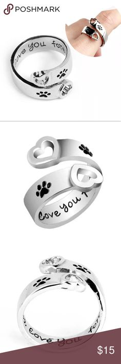 "(F23) Silver Paw Print Heart Ring Ring is one size and does adjust to fit your finger. It's silver in color. The inside says ""I will love you forever"" Jewelry Rings"