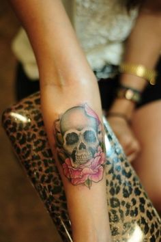 Skull tattoo with pink peony