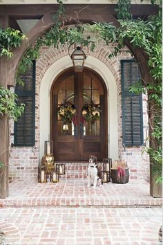 Front door ideas and design to add curb appeal for new house, renovation, new build, or remodel: brick front porch with arched wood stain french front doors House Colors, House Design, New Homes, Exterior Design, House, Brick Exterior House, Brick Fireplace, Exterior Brick, House Exterior