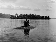 Private Island, Young Couple Embracing on a Small Rock Protruding from the Waters of Lake George Premium Photographic Print by Nina Leen at AllPosters.com