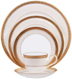 Odessa Gold pattern by Noritake is a 5-piece bone china place setting which features a wide, etched gold band, coupled with an inner band of delicate white floral over a whisper of dove gray. It's not only beautiful but you'll have easy clean up because It's dishwasher safe!