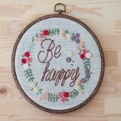 This embroidery work comes framed by wooden embroidery hoop in 20 cm diameter. Colour theme can be customised. Rings will be held in a lace bow. Made to order. We can always customise: - Colours - Quote - Name - Fonts Ask me for any further information. Embroidery Letters, Wooden Embroidery Hoops, Hand Work Embroidery, Embroidery Hoop Art, Ribbon Embroidery, Floral Embroidery, Cross Stitch Embroidery, Cross Stitch Patterns, Painted Name Canvas