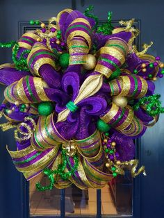 Beautiful Mardi gras wreath with a colorful Jester as the focal point ! Accented with mardi gras ornaments and flex tubing ! Mardi Gras Centerpieces, Mardi Gras Decorations, Mardi Gras Wreath, Mardi Gras Party, Christmas Wreaths, Christmas Decorations, Winter Wreaths, Christmas Stuff, Diy Christmas
