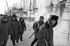 An army of 10,000 workers is hired each winter to build the ice city at Harbin's Ice and Snow World Festival site. Construction is done during the day and during the night and work shifts can sometimes be 12 hours long. Most of the workers are hired locally and a workers earn 100 - 1,000 rmb a day depending upon their skill level and experience.