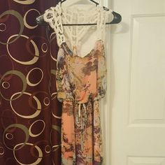 Maxi style dress with lace detail Maxi style dress with lace detail on shoulders and back. Very pretty floral print with slit on left side. Peach pink with cream lace, size small, so perfect for summer! Dresses Maxi