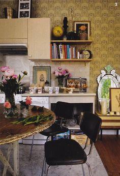 Cosy kitchen nook in the home belonging to architect Laura Gonzalez, wallpaper, open shelving, peonies, vintage, boho, eclectic