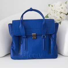 "Phillip Lim Large Pashli Satchel in Cobalt Blue Cobalt Blue 14.5""W x 11.5""H x 5""D 4"" Strap Drop 19""-23"" Shoulder Strap Drop  Gently loved. Used 5x. Includes: Phillip Lim card, shoulder strap & dust bag. Lost the key but never found usage or a need for it.  The bag is in great condition w/ no signs of leather aging. The lock pad does have a few scratches which is common with most Pashli owners. You can't see it unless you look closeup. It's a minor flaw that I never noticed much.  All images…"