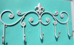 White Fleur de Lis wall decor hook by chicshabbyandunique on Etsy, $21.95