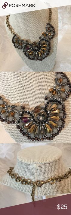 Gorgeous! Multi Beaded Statement Necklace! Gorgeous! Multi Beaded Statement Necklace! Variety of Gold, Smokey Brown, Bronze, Gray Beading designed with an antique gold chain with 18 inch chain and 3 inch extender!  Perfect to dress up any outfit!  Brand New!  Excellent Quality! Jewelry Necklaces