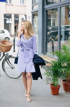 Katarzyna Tusk is looking super relaxed in this cute striped shirt dress from Zara. A shirt dress with a belt is perfect because not only does it provide a cute summer style but the belt will also enhance your silhouette and show off your figure!
