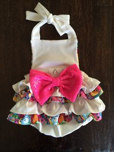 Shopkins ruffle romper is the perfect outfit for Spring/summer or any occasion! -Made with cotton fabric, and soft ponte de roma knit fabric. Gorgeous 7 inch sparkle big bow. Measurements: Up to 7lbs